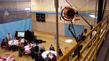I used a powerful hot light to provide some fill on the speakers during their testimonials, luckily I was able to mount it on the indoor track above the event along with a couple of my camera angles.