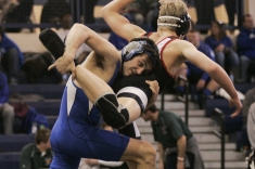 (Saturday February 9th 2014 - Warren Fitzgerald High School - Athletic Gym - Warren, MI) David Morrow of Lamphere High School (left) takes down his Divine Child opponent Saturday at the MHSAA wrestling Disctrics at Warren Fitzgerald High School. Photo by: Brian B. Sevald